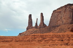 Three Sisters and Mitchell Mesa, Monument Valley.